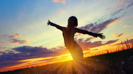 Young woman's silhouette over sunset light Stock Photo - 5964608