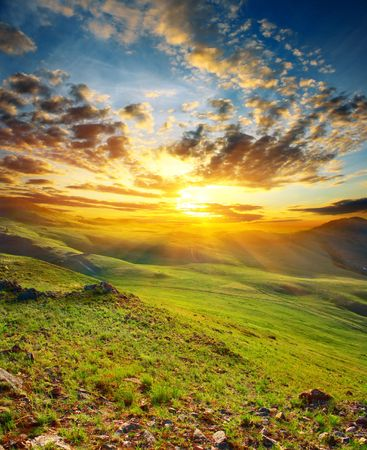 Sunset in mountains photo