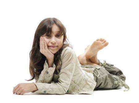 preschooler: Little smiling girl lying on surface Stock Photo