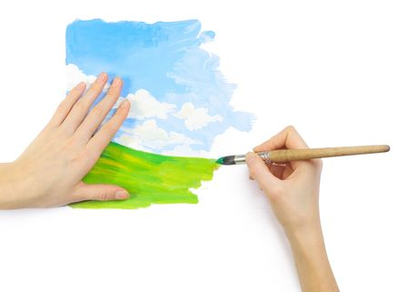 hand painting: Hands with brush and bright image Stock Photo