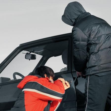 Young guys breaking door of a car photo