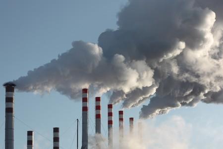 Plants tubes with smoke and blue sky photo