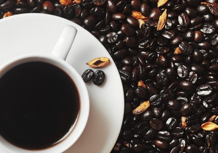 Cup of coffee with cardamom seeds photo