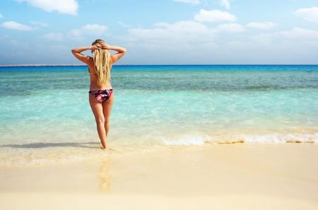 swimm: Alone woman going to swimm in blue sea Stock Photo