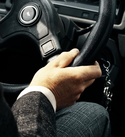 Hand on steering wheel photo