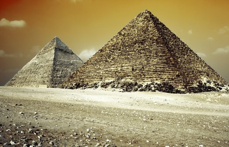 Grate pyramids in Giza valley with red sky photo