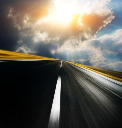 race track: Empty asphalt blurry road with cloudy sky and sunlight  Stock Photo