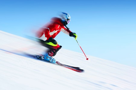 skiing: Ski rider in motion. Blurred back and sharp front Stock Photo