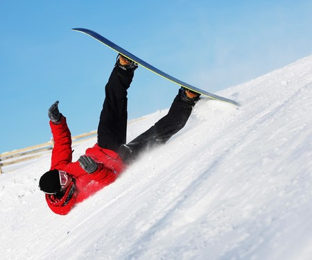 skiing accident: Snowboard sportsmen in fall over clear blue sky Stock Photo