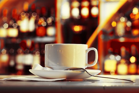 Cup with tea and sugar on plate in night club Stock Photo - 7297405