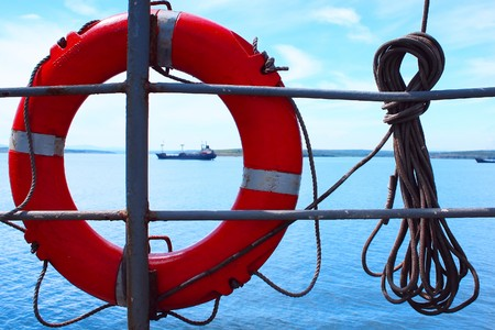 Red bouy on ship with rope photo