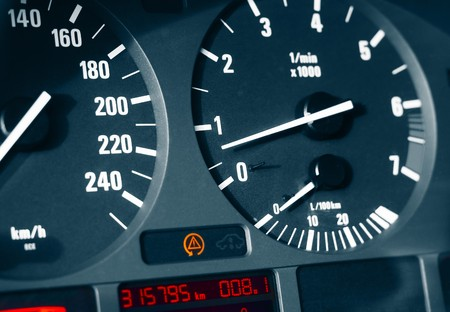 Car dashboard with speedometer (kmh) and tachometer photo