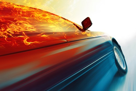 drive way: Sport car with burning roof in motion on icy road Stock Photo