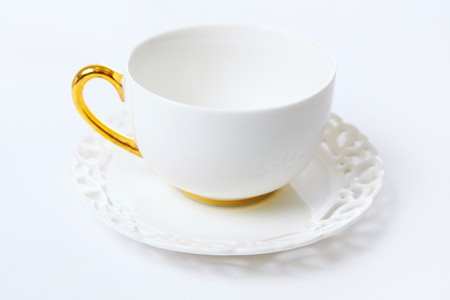 White empty tea cup on gray background photo