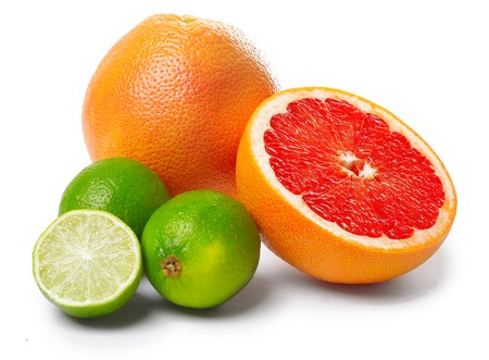 Citrus fruits lime and grapefruit with slices isolated on white Stock Photo