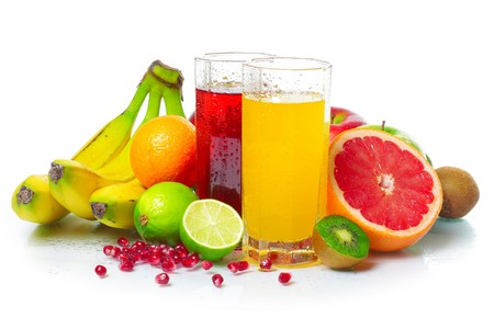 Tropical wet fruits with glasses on white background photo