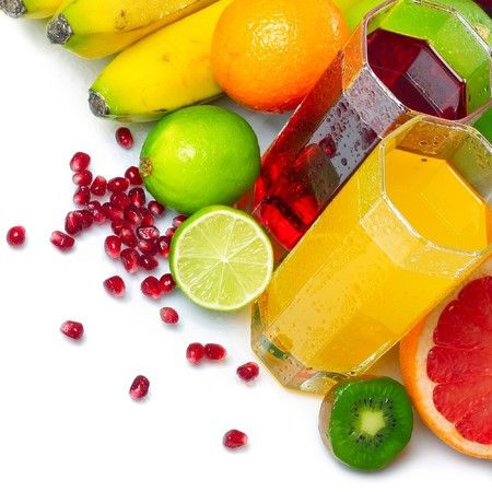 Ripe fruits and glasses with juice photo