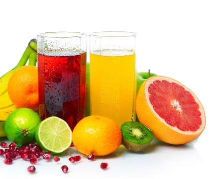 Wet ripe fruits with juice glasses on white background photo