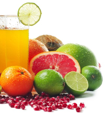Wet ripe tropical fruits and glass with juice photo