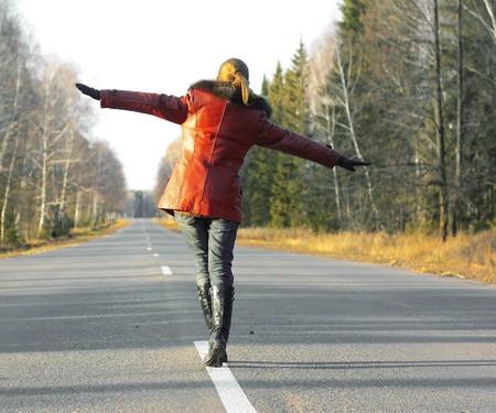 Alone woman walking on road photo