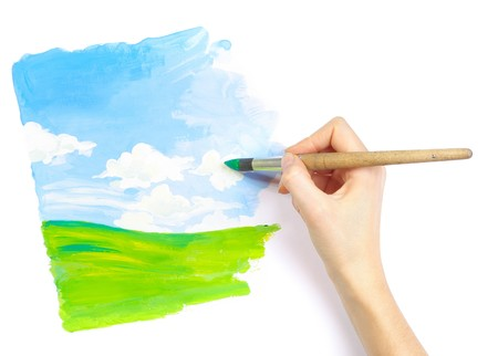 Hand with brush drawing a picture photo