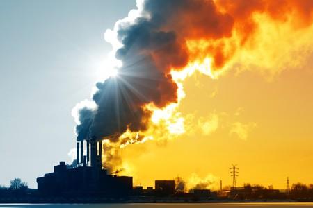 Power plant with orange smoke photo