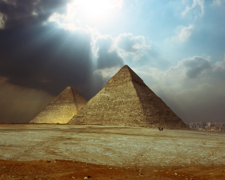 Sunlight over grate Giza pyramids. photo