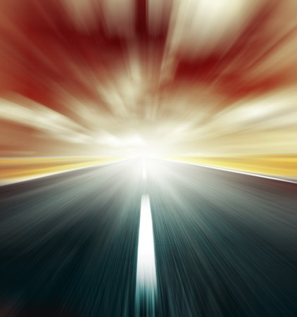 Blurry road and blurry sky with light and red clouds Stock Photo - 7298126