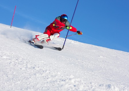 Ski sportsmen in motion under clear blue sky Stock Photo - 7294081