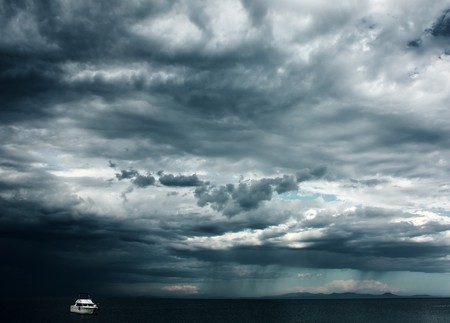 wind force: Alone white little boat in sea with storm weather Stock Photo