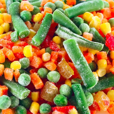 Frozen vegetables with ice photo