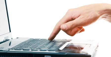 Hand above computer keyboard photo
