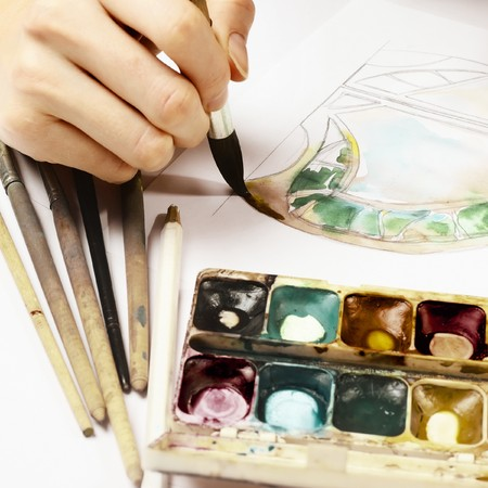 masterpiece: Hand with brush and paint Stock Photo