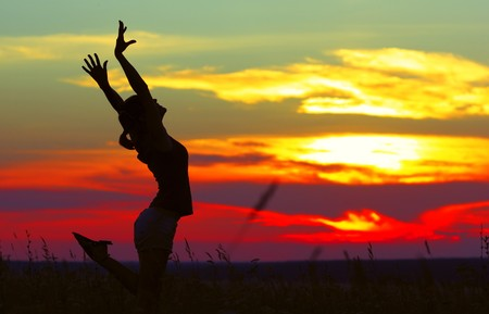 woman meditating: Young woman doing exersices under sunset light