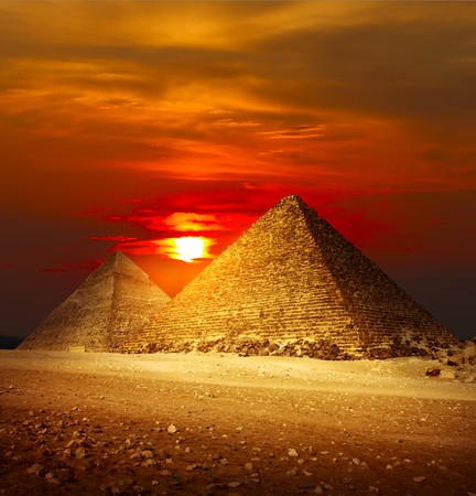 pyramid shape: Pyramids in Giza valley under sunset light Stock Photo