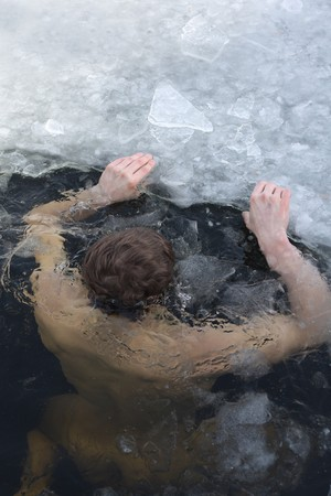 drowning: Winter swimmer Stock Photo
