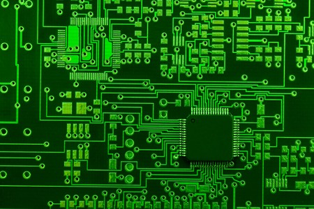 Close-up image of green board made for surface mount technology with one many-pins semiconductor component Stock Photo - 7585720