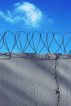 concentration camp: Wall with barbed wire Stock Photo