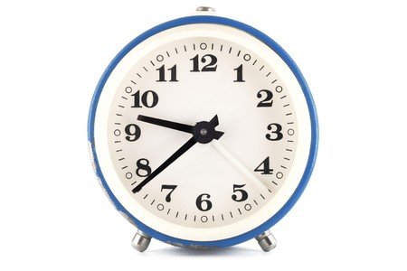 front desk: Blue clock over white