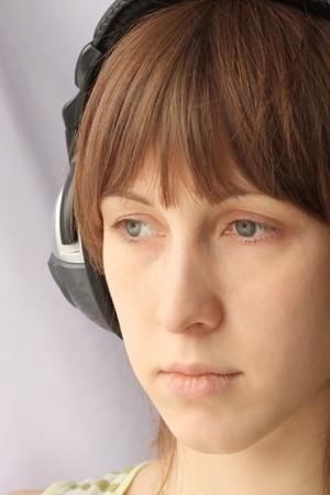 sadly: Sadly young woman with headphones