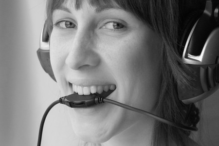 sound bite: Happy woman biting wire of headphones