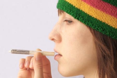 jah: Young woman going to smoke