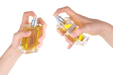 Perfume bottles in hands. Series photo