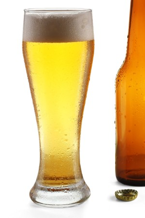 Glass with beer and empty bottle Stock Photo - 7584733