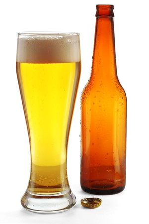 near beer: Glass with beer and empty bottle