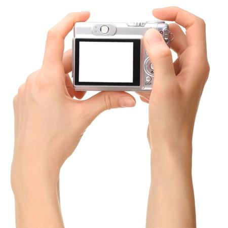 Camera in hands photo