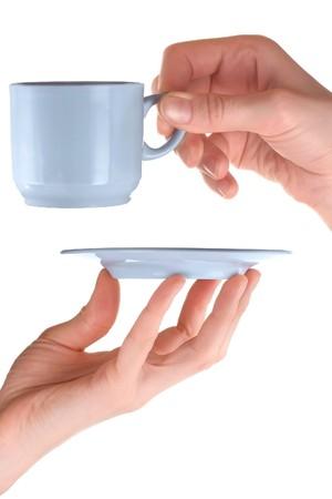 Tea set in hands photo