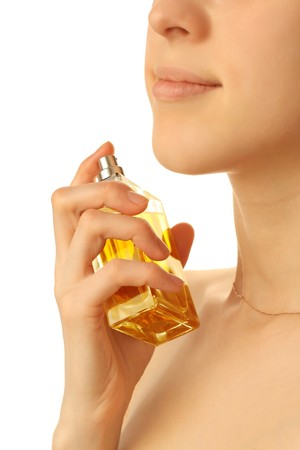 Young woman with perfume bottle photo