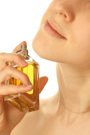 Young woman with perfume photo