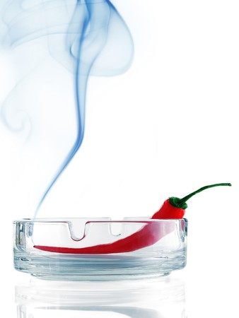 Burning chili pepper with smoke Stock Photo - 7583599